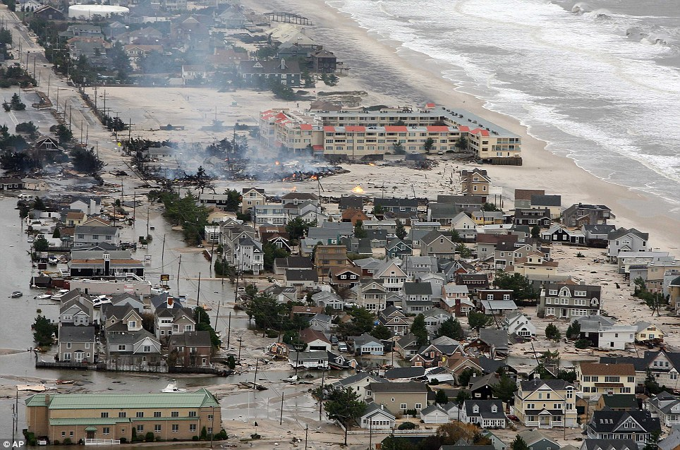 On fire: This photo from the New Jersey Governor's Office shows damage north of Seaside, New Jersey, on Tuesday after Superstorm Sandy made landfall
