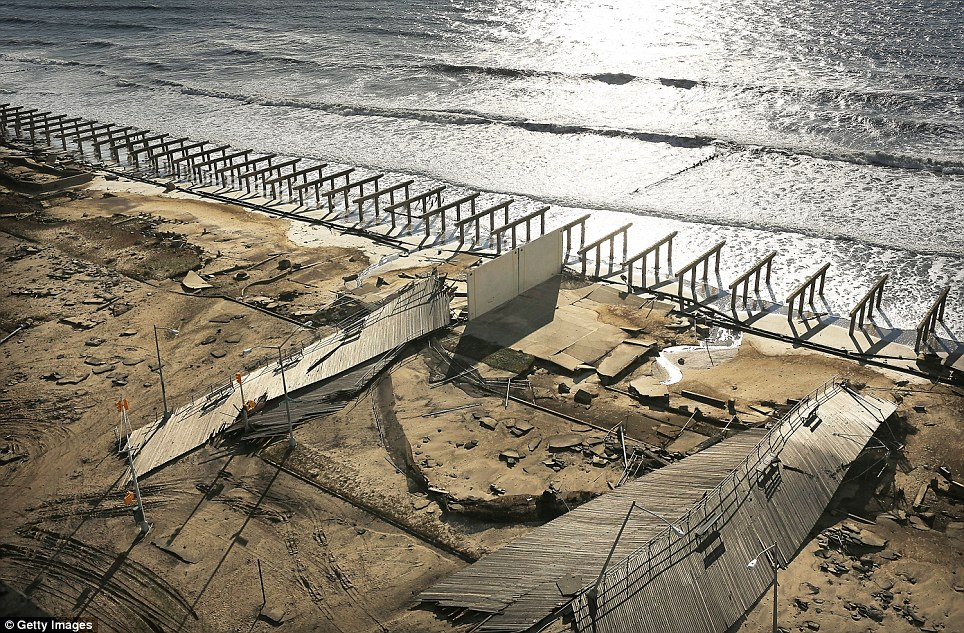 All that's left: The foundations to the historic Rockaway boardwalk are all that remain after it was washed away during Superstorm Sandy in Brooklyn, New York