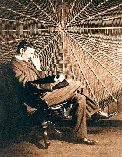 "Above: Nikola Tesla, with Roger Boskovich's book ""Theoria Philosophiae ..."